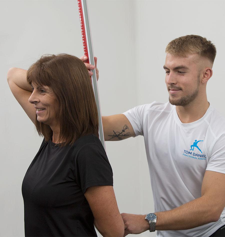 Client demonstrating the shoulder mobility test